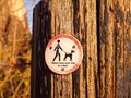 Public walking wooden sign post dog sign please keep your dog on Royalty Free Stock Photo
