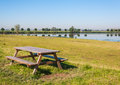 Public wooden picnic table in a nature reserve Stock Photo