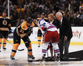 Puck ceremony at td garden boston ma bruins center patrice bergeron and ny rangers center derek stepan watch the drop center ice Stock Image