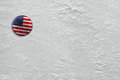 Puck on ice washer with the image of the american flag a hockey rink Stock Photo