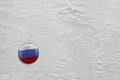 Puck on ice washer with the image of the russian flag a hockey rink Stock Images
