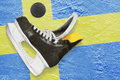 Puck, skates and Swedish flag Stock Image