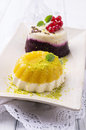 Pudding desserts as closeup on a beige plate Stock Image