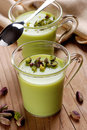 Pudding flavored with pistachio into glass cup Stock Photography