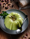 Pudding flavored with pistachio ingredients around Stock Image