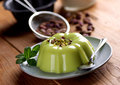 Pudding flavored with pistachio ingredients around Royalty Free Stock Images