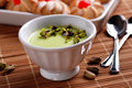 Pudding flavored with pistachio in white ceramic bowl Royalty Free Stock Photos