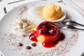 Pudding with strawberry jam and ice cream dessert Royalty Free Stock Photo