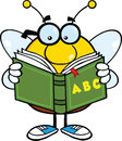 Pudgy Bee Cartoon Character With Glasses Reading A ABC Book Royalty Free Stock Photo