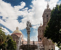 Puebla cathedral fountain the with its two towers the tile yellow dome and a with sculptures mexico Royalty Free Stock Image