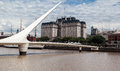 Puente de la mujer bridge argentina the woman s in puerto madero and the facade of libertador building the headquarters of Stock Photos