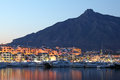 Puerto banus at dusk spain marina of marbella Stock Image