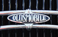 Puerto de la cruz july oldsmobile symbol on anique luxury car at town boulevard in founded in Royalty Free Stock Photo