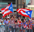 Puerto rican day parade spectators at the national holding large flags in new york city along th avenue Stock Photography