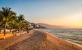 Puerto Vallarta sunset and palms - Puerto Vallarta, Jalisco, Mexico Royalty Free Stock Photo