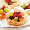 Puff pastries with berry fruits and whipping cream Stock Photo