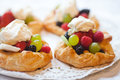 Puff pastries with fruits and whipping cream Royalty Free Stock Photo