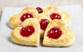 Puff pastry cookies in heart shape filled with cherries Royalty Free Stock Photo