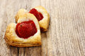 Puff pastry cookies in heart shape filled with strawberries Royalty Free Stock Photo