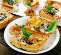 Puff pastry Mushroom tarts on a wooden table Royalty Free Stock Photo