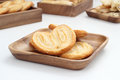 Puff pastry is placed in a wooden plate on white table Royalty Free Stock Images