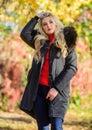 Puffer jacket with hood. Woman wear black parka fur hood. Classic parka coat has become wardrobe icon. Versatile