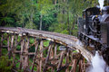 Puffing billy train steam travels across an old wooden bridge in melbourne victoria australia Stock Images