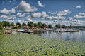 Puffy clouds, blue sky above a town on Malaren lake, Sweden Royalty Free Stock Photo