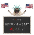 Pug puppy dog with American flag and statue of liberty crown, behind blackboard with text happy 4th of July and independence day Royalty Free Stock Photo