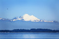 Puget sound and mt baker mount under blue skies sits above washington it is one of the snowiest places in the world is an active Royalty Free Stock Photos