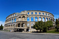 Pula arena croatia ruins of the best preserved roman amphitheatre fragment of arched walls surrounded by spring scenery Royalty Free Stock Images