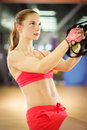 Pull ups young attractive woman does with fitness straps in the gym s studio Royalty Free Stock Photos