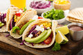 Pulled pork tacos with red cabbage and avocados Royalty Free Stock Photo
