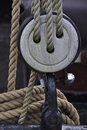 Pulley with ecru rope wooden detail of a vintage sailer Royalty Free Stock Images