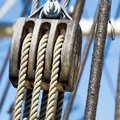 Pulley with hemp ropes, as construction of a triple pulley for the rigging of a sailing ship Royalty Free Stock Photo
