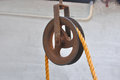 Pulley with a rope used in wells to pull water Royalty Free Stock Photos