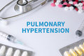 Pulmonary hypertension text on background of medicaments composition stethoscope mix therapy drugs doctor flu antibiotic pharmacy Royalty Free Stock Photography