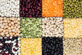 Pulses food background, assortment - legume, kidney beans, peas, lentils in square cells closeup top view.