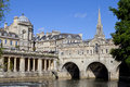 Pulteney bridge and the river avon in bath st michael s church can be seen in background Stock Photography