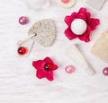 Pumice stone and bath set on white wooden table Royalty Free Stock Photos
