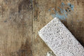 Pumice stone raw on rustic wooden background Stock Images