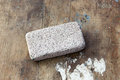 Pumice stone raw on rustic wooden background Stock Photo