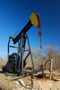 Pump jack in countryside Stock Photography