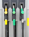Pump nozzles yellow and green at the gas station Stock Photo