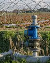 Pump for water to irrigate the fields Stock Photos