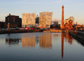 The pumphouse seen across albert dock liverpool view part of area in merseyside looking towards and other more modern buildings in Stock Photos