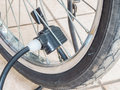 Pumping air into tire of bicycle Royalty Free Stock Photo