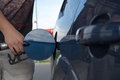Pumping gas at gas pump closeup of man gasoline fuel in car station Royalty Free Stock Photos