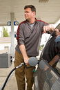 Pumping Gas at the Gas Station Royalty Free Stock Photo