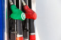 Pumping gas at  pump. Closeup of man  gasoline fuel in car   station. Royalty Free Stock Photo